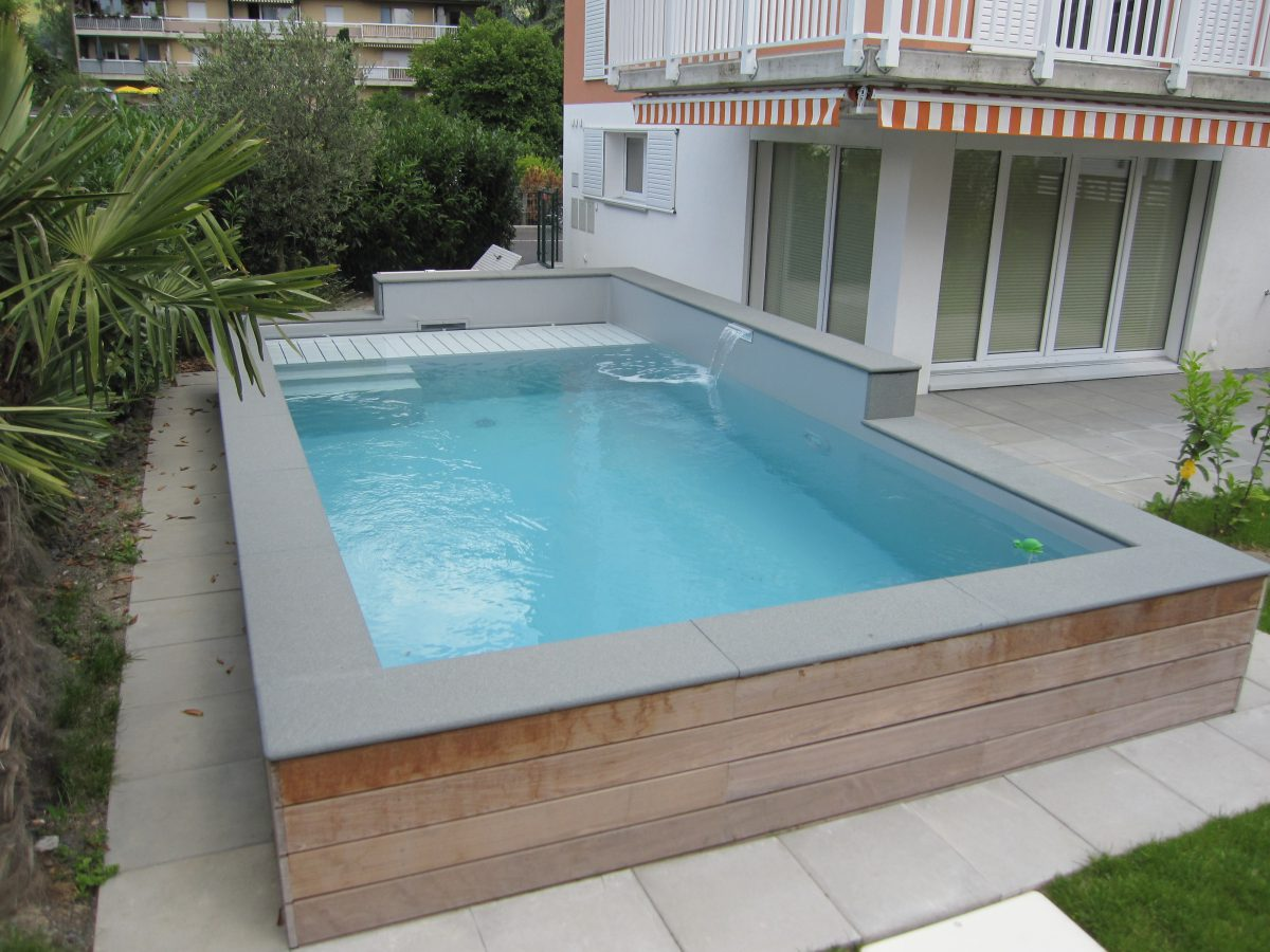 Piscine semi enterr e beton fashion designs for Prix piscine aquilus